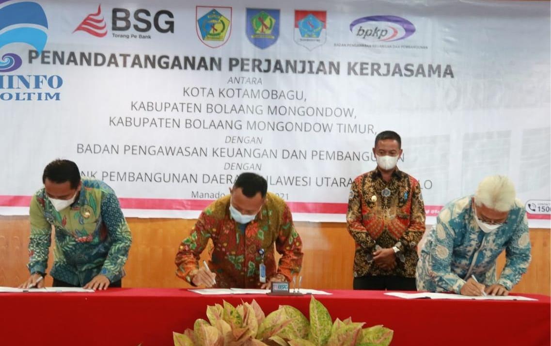 Penandatanganan nota kesepahaman antara Pemkab Boltim, BPKP Sulut dan BSG.