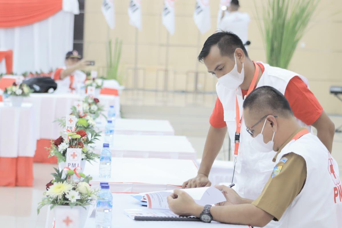 Pengurus PMI Bolmut,masing Avit Coen Pontoh dan Sofian Mokoginta menghadiri Mukerprov dan Musrov PMI Sulut.